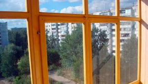 Остекление балконов деревянными рамами