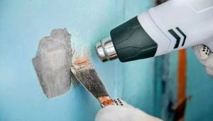 Как снять старую краску со стен?