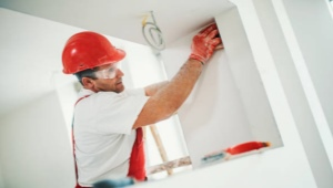Как крепить гипсокартон к стене?