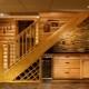 Как можно обустроить пространство под лестницей: способы