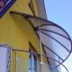 Козырьки над балконами: особенности конструкции и способы монтажа