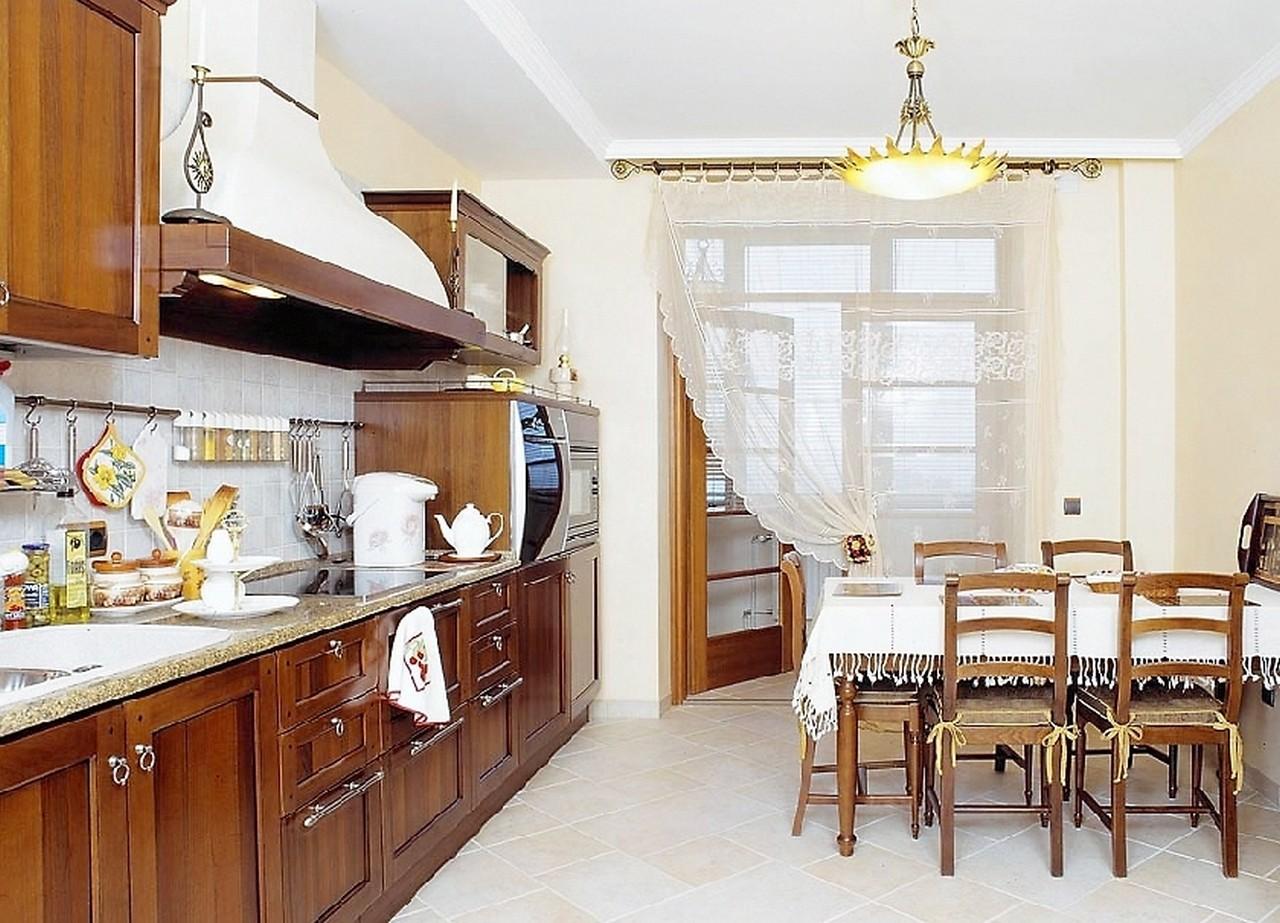 Полукруглый балкон на кухне дизайн фото.