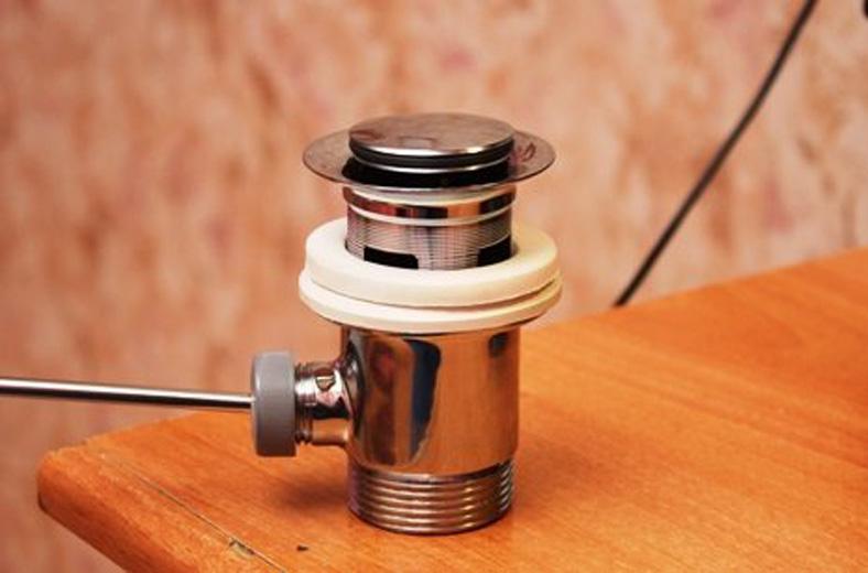 Донный клапан предназначение устройство  инструктаж по замене