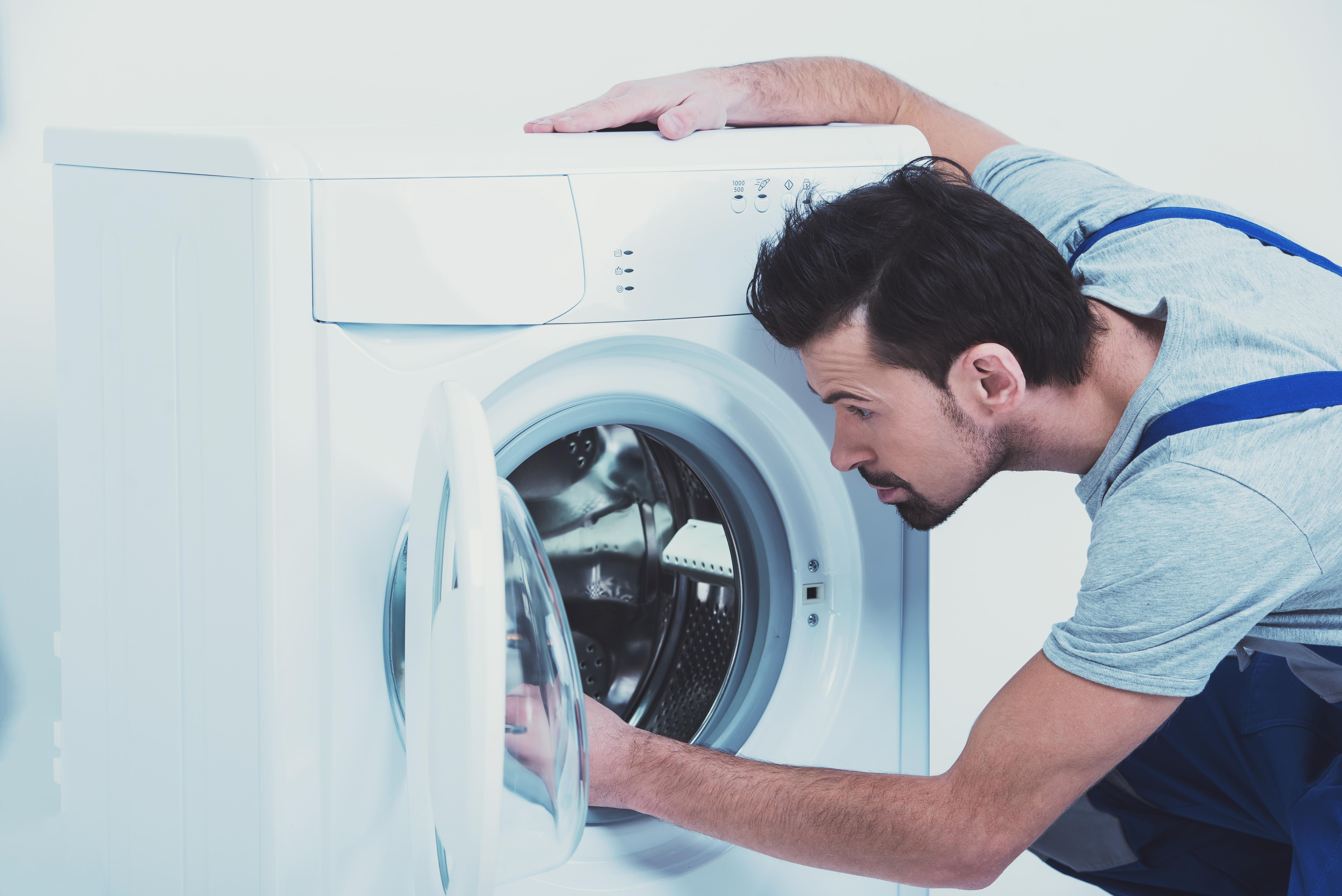 Стиральная машина зависает на отжиме: причины, что делать